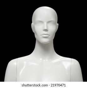 Female mannequin isolated on black background.