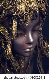 Female Mannequin in metal headwear