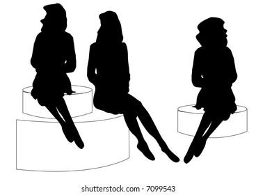 female mannequins sitting on round discs