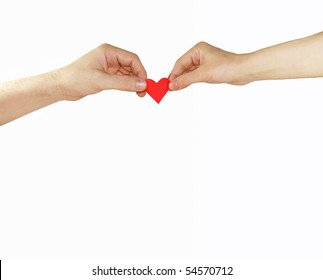 Female and man's hands with red heart