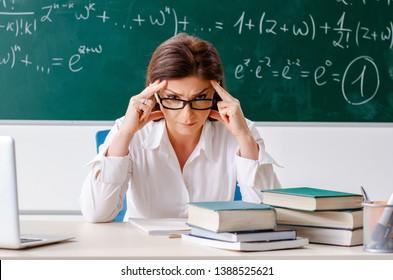 Female math teacher in front of the chalkboard