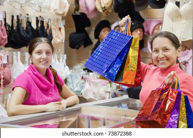 Female mature customer with shopping bags at  counter in   sho