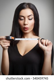 Female With Measuring Tape.
