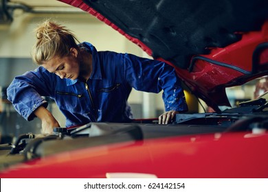 Female mechanic working on car