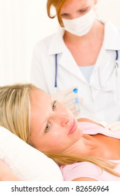 Female medical doctor apply injection woman patient