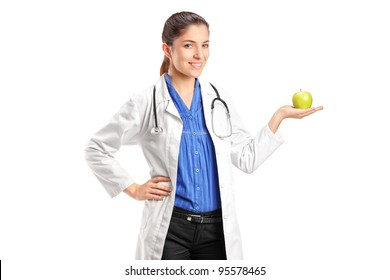A female medical doctor with stethoscope holding an apple isolated on white background