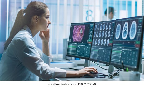 Female Medical Research Scientist Working with Brain Scans on Her Personal Computer. Modern Laboratory Working on Neurophysiology, Science,  Neuropharmacology. Understanding Human Brain.
