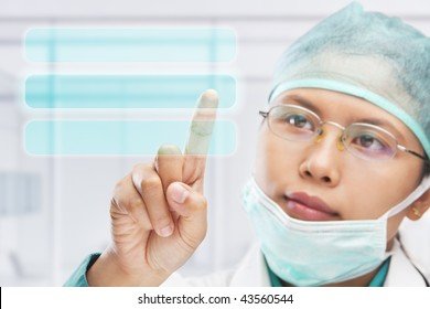 female medical worker or researcher or scientist touching virtual button panel