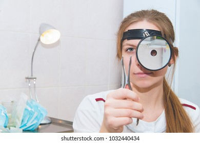 Female medicine doctor examining patient with nasal mirror. Healthcare, medical service and insurance concept. Otorhinolaryngologist or ENT examination.