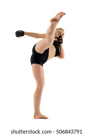 Female MMA fighter delivering a high kick