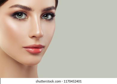 Female model face on background with copy space