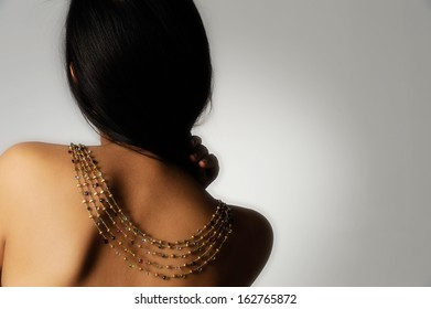 female model with golden necklace