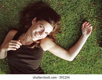 female model laying in grass