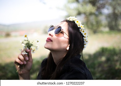 female model photography between flowers