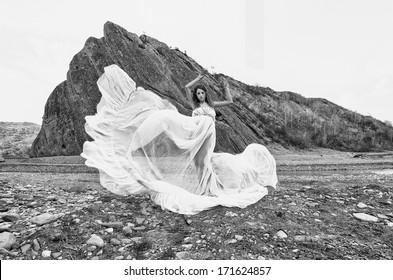 female model posing in a beautiful landscape