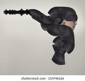 Female model profile in a black bizarre and surreal headgear