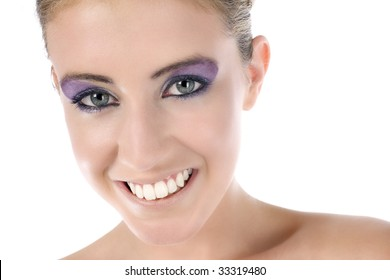 Female model with strong eye makeup smiling on white background