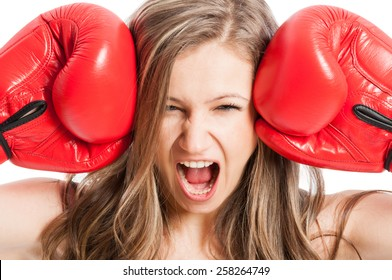 Female model wearing red boxing gloves screaming or shouting expressing madness or angry