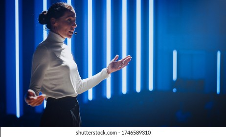 Female Motivational Speaker on Stage, Talking about Happiness, Diversity, Success, Leadership, STEM and How to Be Productive. Woman Presenter Leads Tech Business Conference. Low Angle Portrait