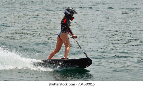 Female Motosurf Competitor moving at speed.