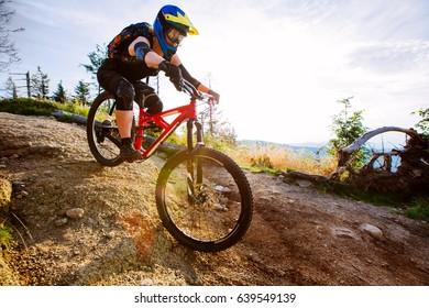 Female mountain biker riding downhill