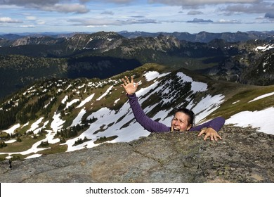 A female mountain climber yells for help in a (staged!) fall from a cliff.