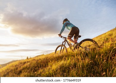Female mountainbiker riding on a trail in the mountains