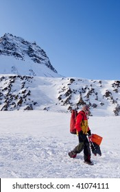 A female mountaineer against a winter mountain landscape