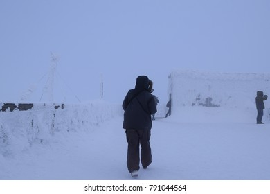 Female Mountaineer in heavy snowfall