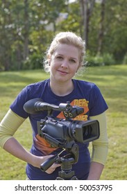 female movie makers, filming a project outdoors