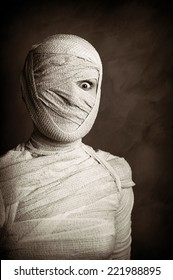 female mummy in grungy sepia vintage horror halloween style