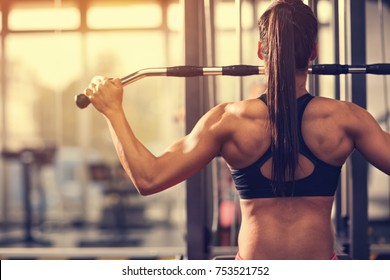 Female muscular bodybuilder exercising