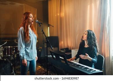 Female musician accompanying a vocalist