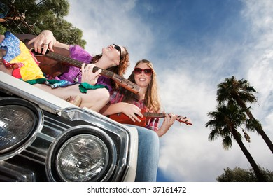 Female Musicians on an Old Car