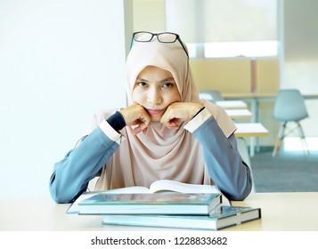 Female Muslim stress study facing camera