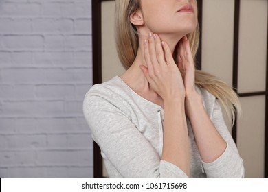 Female neck and shoulders close up. Woman thyroid gland control.