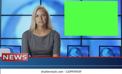 Female News Presenter in Broadcasting Studio With Green Screen Display for Mockup usage.