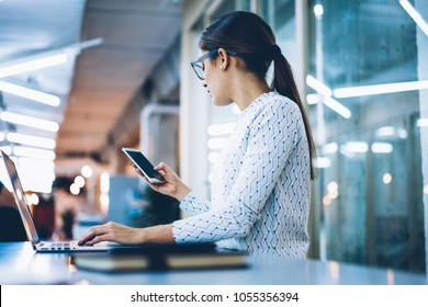 Female office manager using smartphone banking app checking balance and bills for payment, receptionist holding cellular sending mailing information for clients organizing schedule of clinic work
