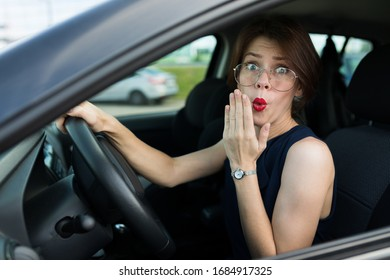 Female in office suit ariives at work by car and need to help