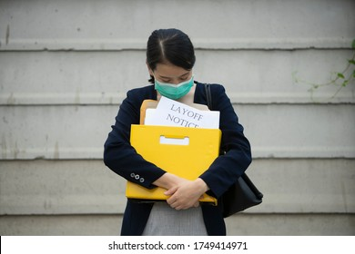 female office worker feeling sorrow and sadness holding Layoff notice after Covid-19(coronavirus),novel coronavirus disease 2019,COVID-19,nCoV spread and Covid-19 lock down Company recession and jobs