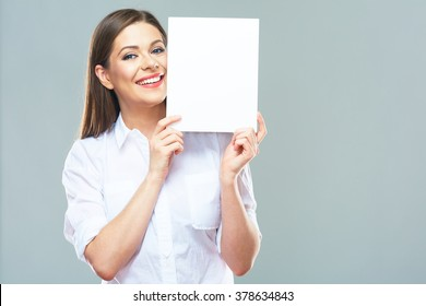 Female office worker hold white blank sign board. Isolated studio portrait of smiling business woman with long hair.