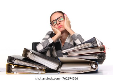 Female office worker sitting at the desk with papers document. Tired and exhousted business woman.