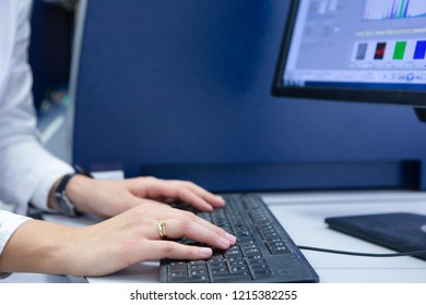 Female office worker typing on the keyboard Close-up