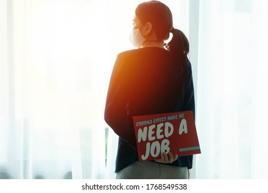 female  officeworker holding Layoff notice after Covid-19(coronavirus) spread and Covid-19 lock down Company recession and jobs hit by pandemic