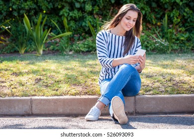 female on a smart phone in an urban street location