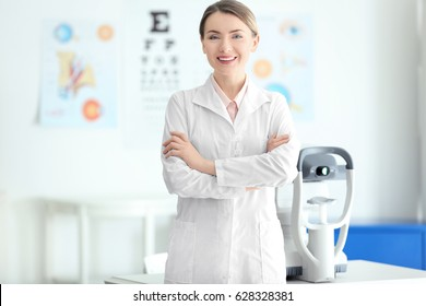 Female ophthalmologist with crossed arms in clinic
