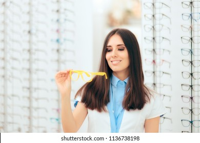 Female Ophthalmologist Eye Care Specialist in Modern Optic Store. Oculist in modern clinic surrounded by eyeglasses frames