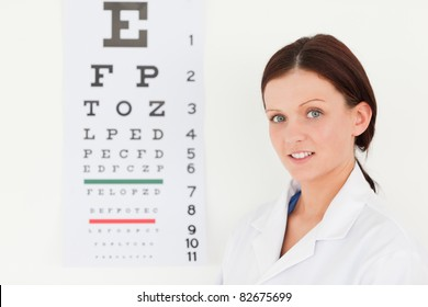 A female optician with an eye test