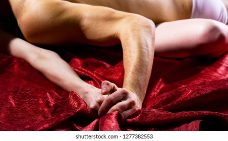 Female orgasm. Sex and pleasure concept. Feeling of intense sexual pleasure. Hand squeeze bedclothes. Moaning in sex ecstasy. Naked lovers passionate sex. Passionate couple have sex make love.