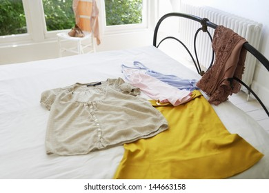 Female outfit laid out on bed